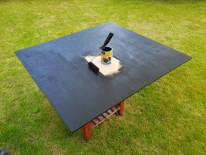 Sonnenkollektor schwarze Holzplatte